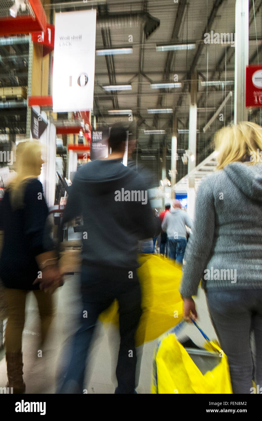 Panic buying rushing rush shopping ikea leeds Birstall retail park Batley Photo blurry to imply speed and movement - Stock Image