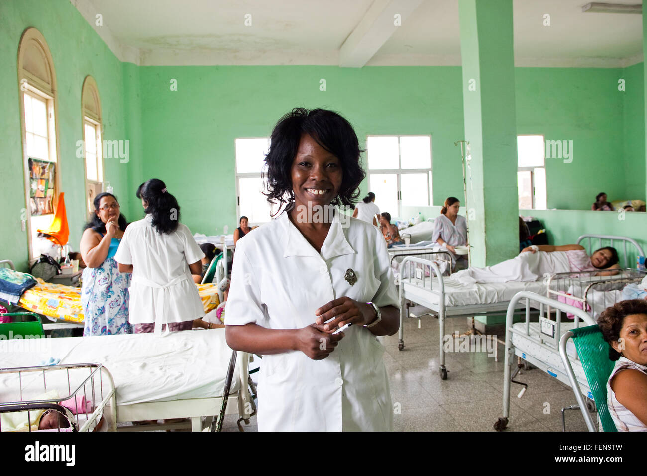 A nurse on the ward in central Havana's maternity hospital, Cuba (permission to photograph was given by mothers) - Stock Image