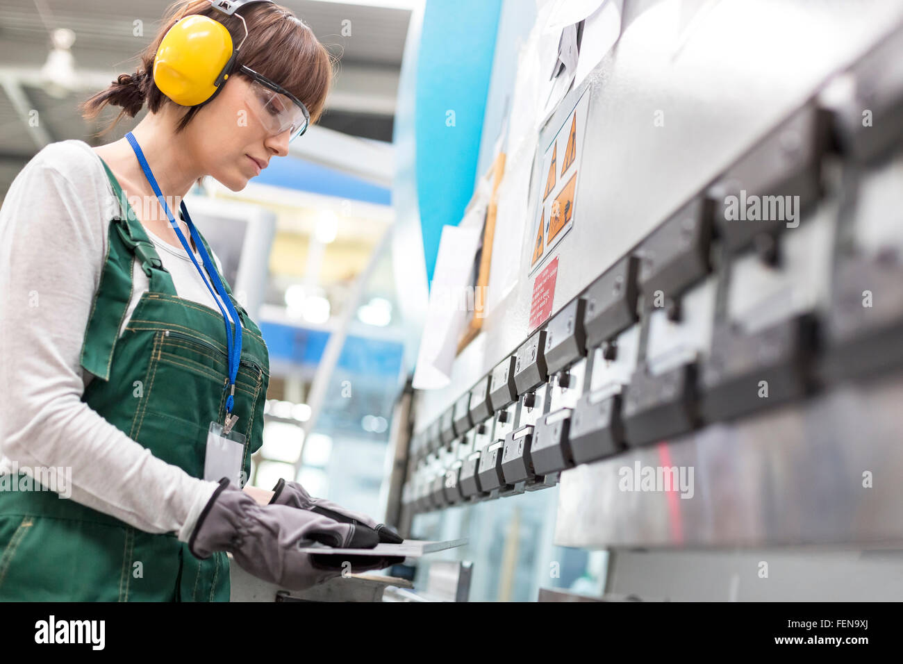 Female worker working in factory - Stock Image