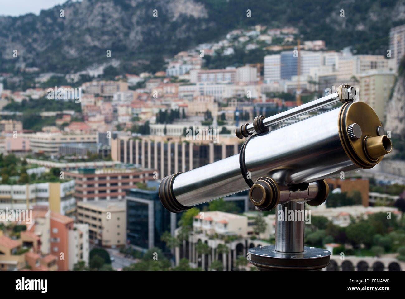 Coin operated telescope overlooking city - Stock Image