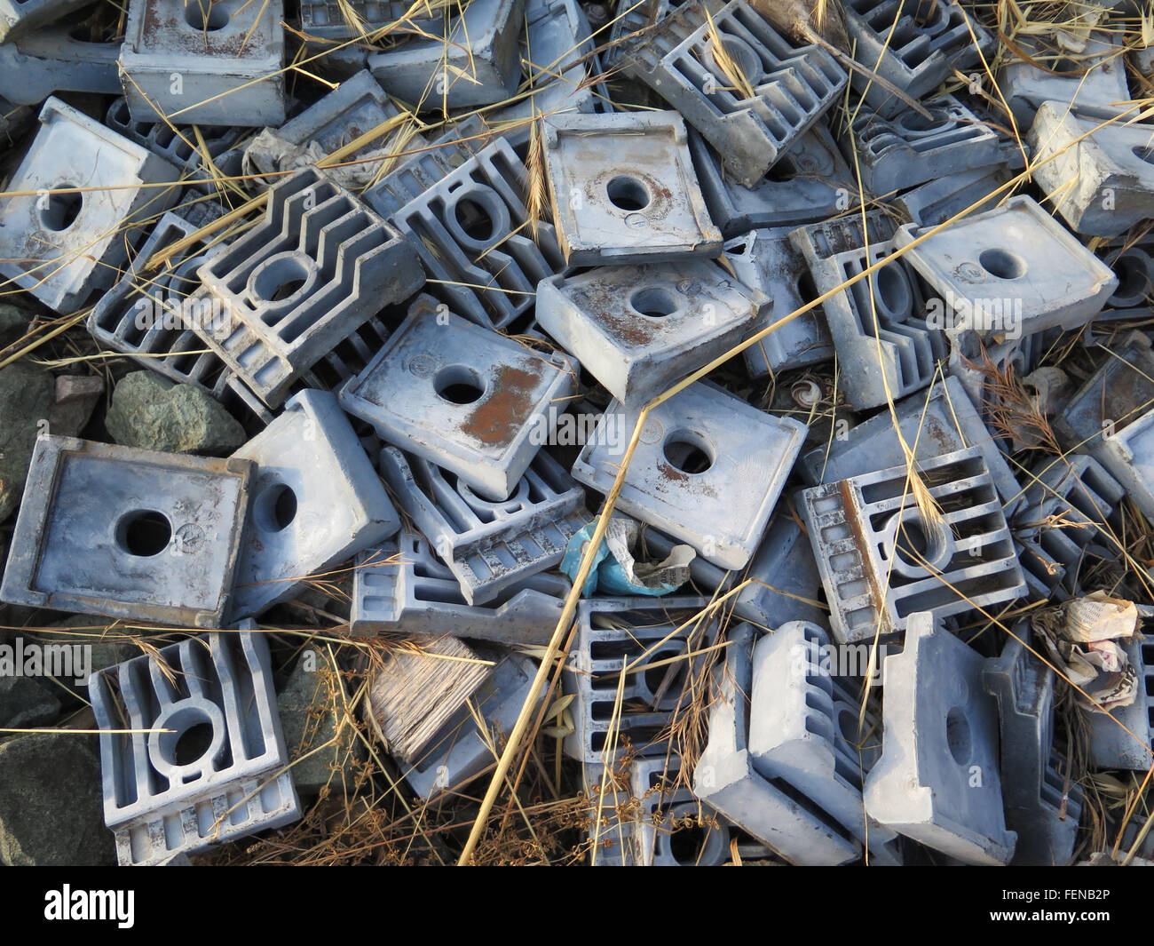 Big pile of used railway sleeper clips next to railway line, Alora, Andalucia - Stock Image