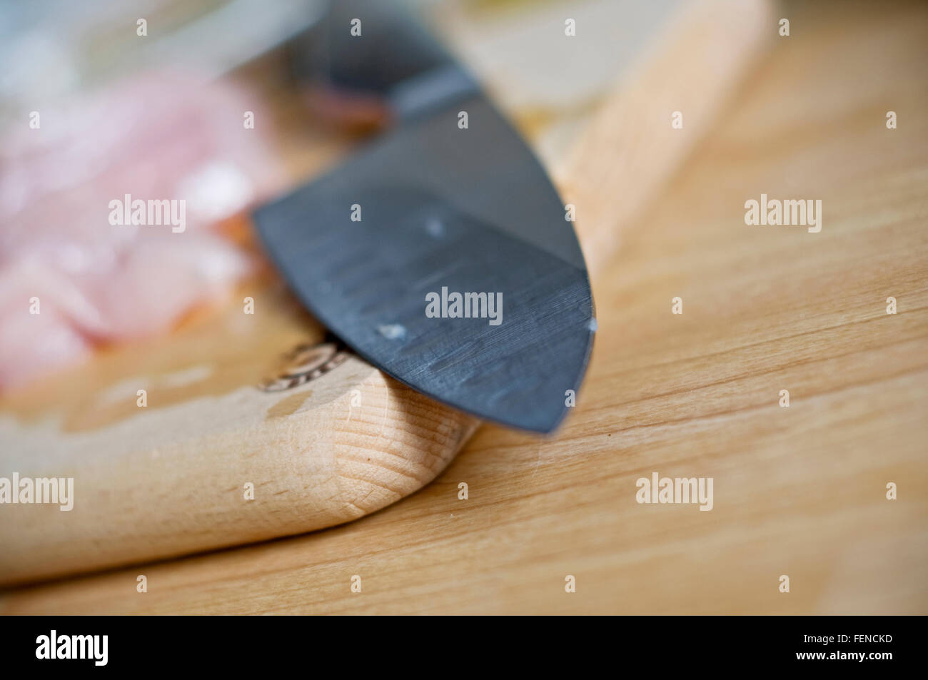 Close-Up Of Kitchen Knife On Cutting Board - Stock Image