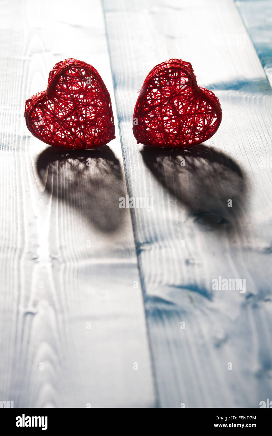 Two Red Heart Shaped String On Plank - Stock Image