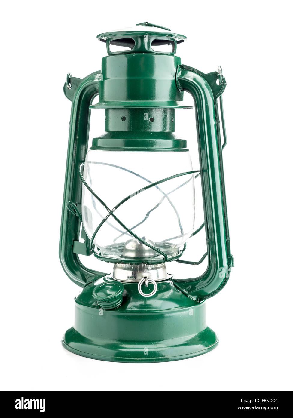 Vintage green oil lamp on white background - Stock Image