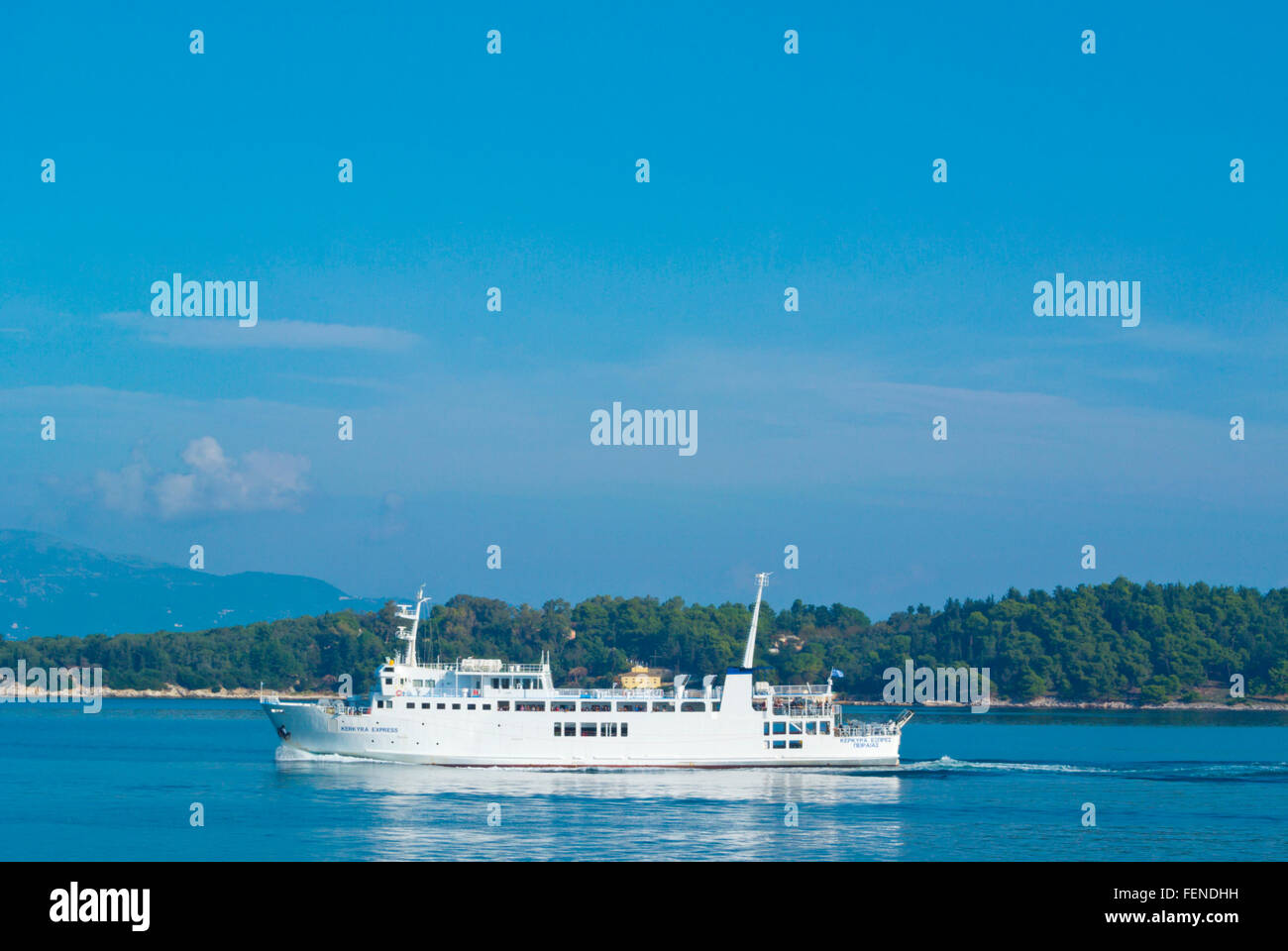 Small boat between Corfu and Vido, in front of Corfu town, Ionian islands, Greece - Stock Image