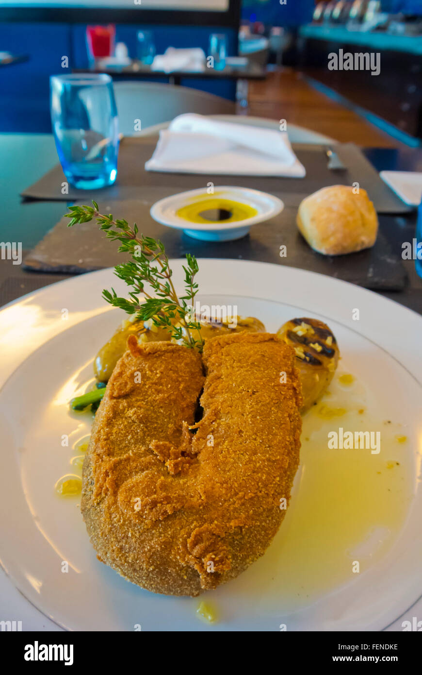 Breaded blood sausage in Azores style, Lisbon, Portugal - Stock Image