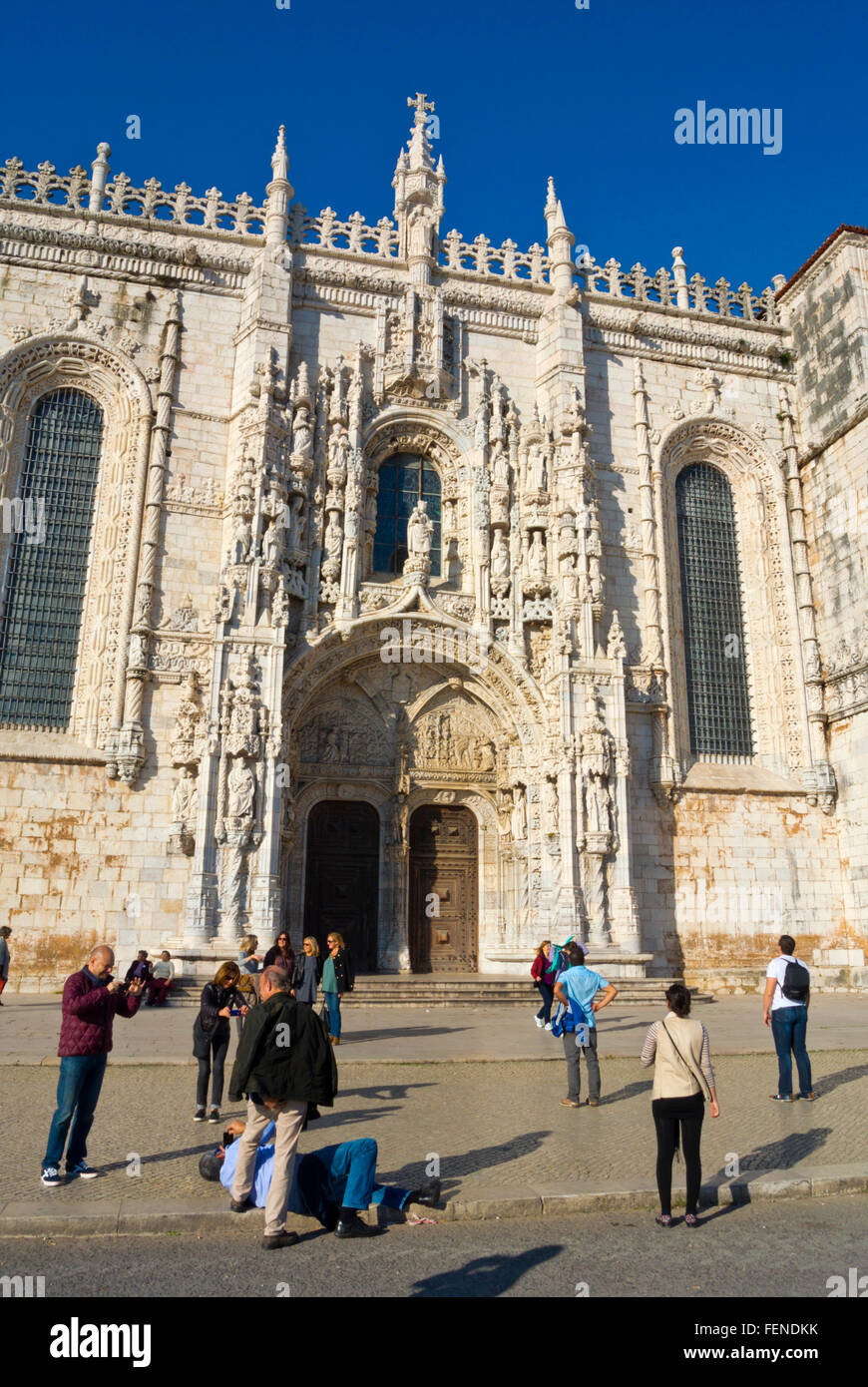 People taking photos, in front of Mosteiro dos Jerónimos, Jeronimos monastery, Belem, Lisbon, Portugal - Stock Image