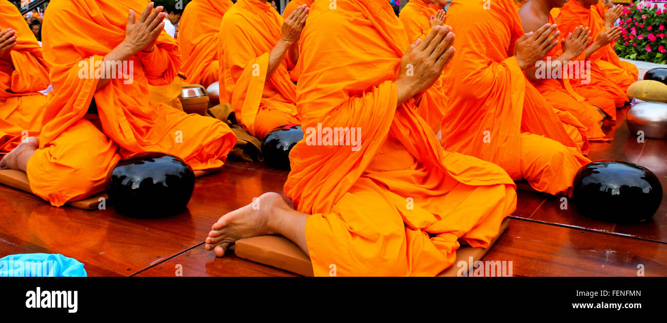 Low Section Of Monks Praying With Joined Hands - Stock Image