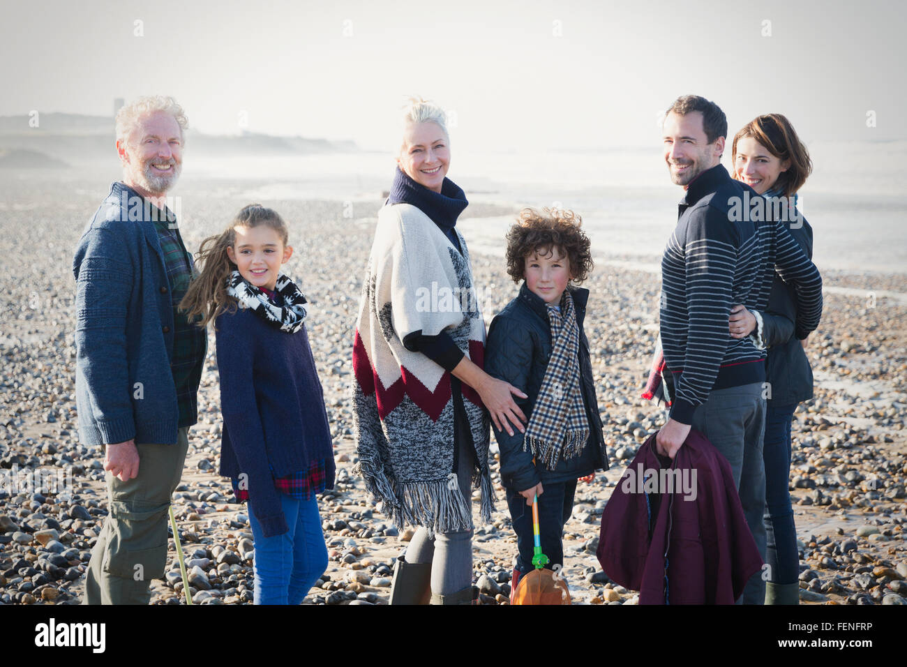 Portrait smiling multi-generation family on sunny beach - Stock Image