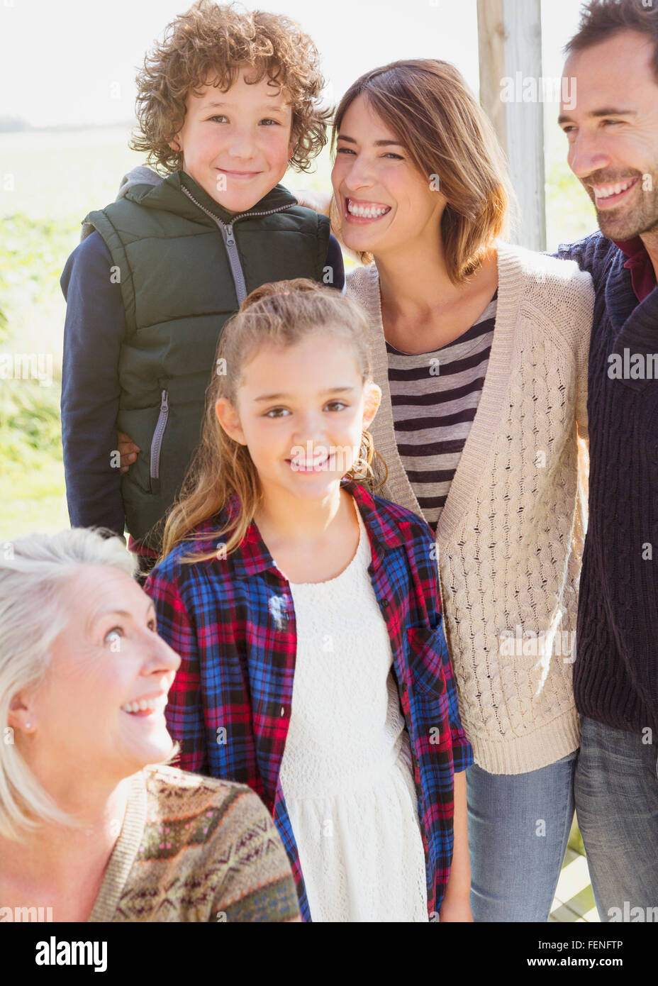 Portrait smiling multi-generation family on porch - Stock Image