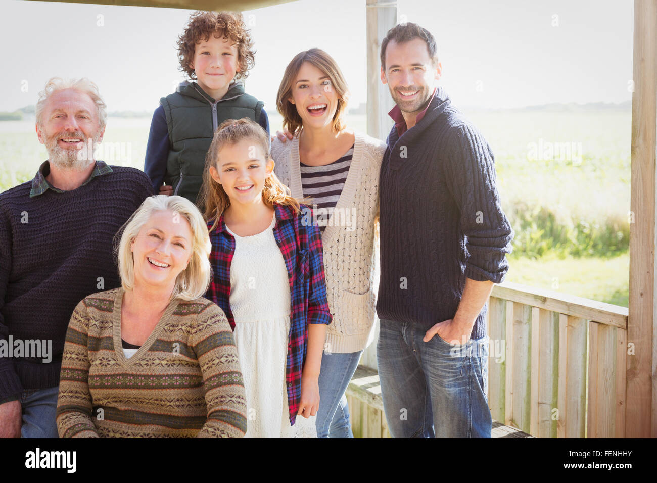 Portrait smiling multi-generation family on sunny porch - Stock Image