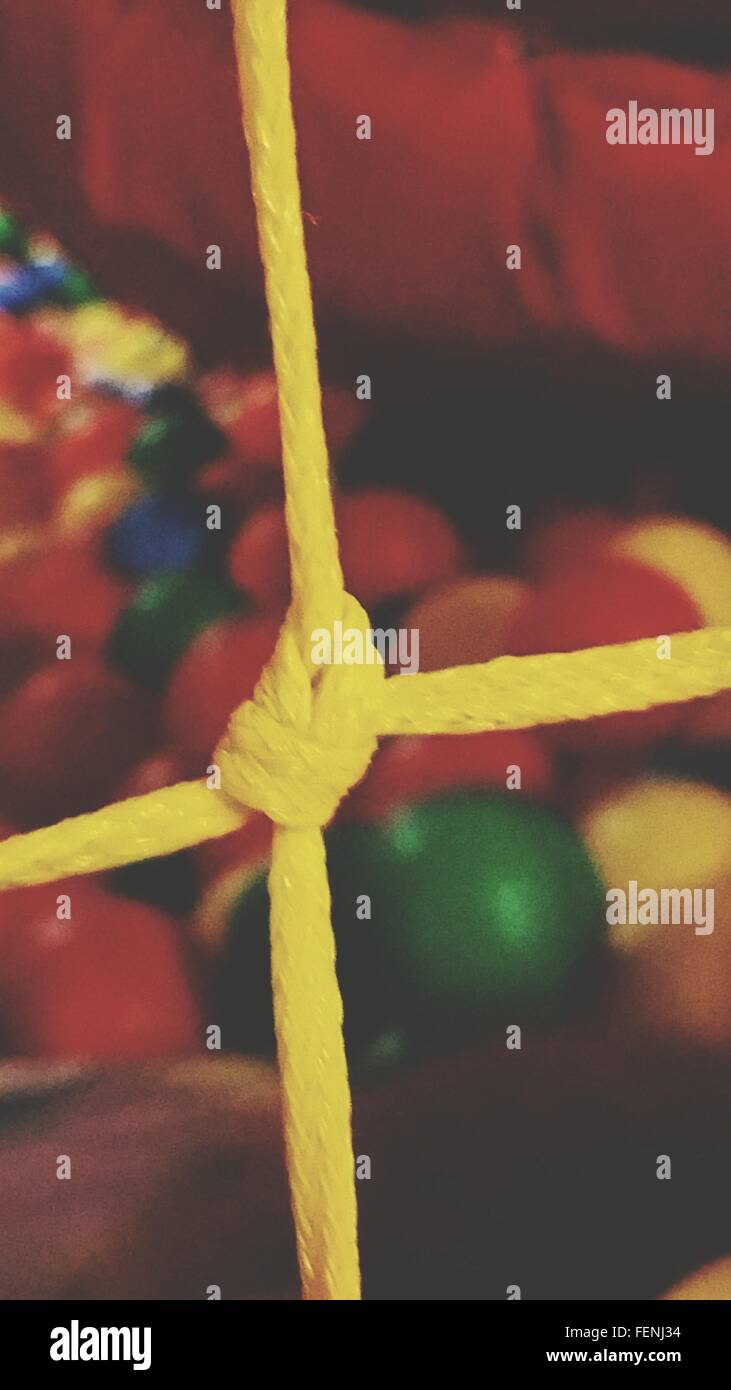 Close Up Of Tied Rope In Ball Pool - Stock Image