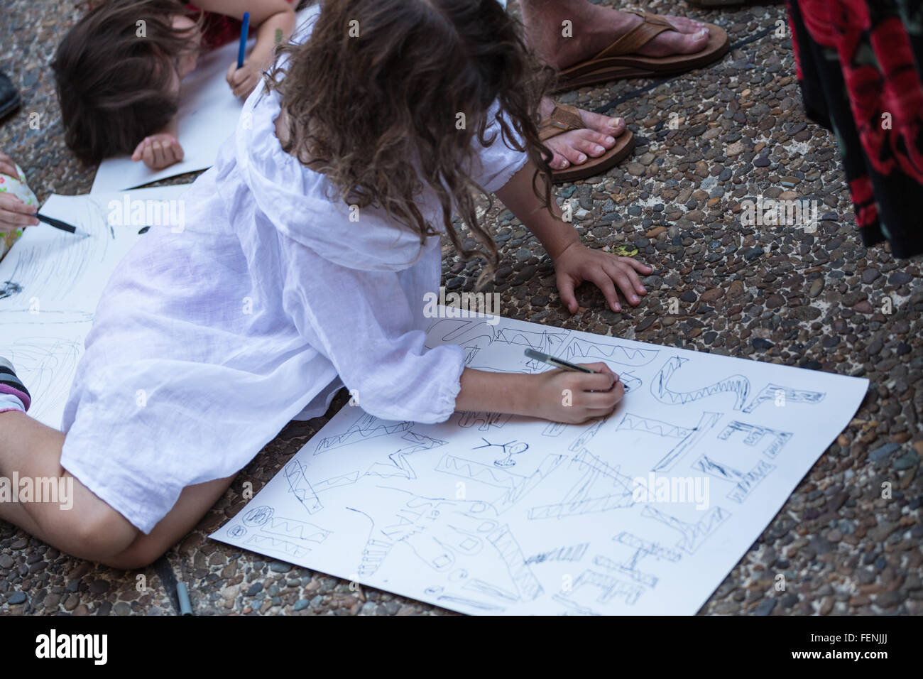 Sydney, Australia. 08th Feb, 2016. Young children join in writing messages against the federal Governments offshore - Stock Image