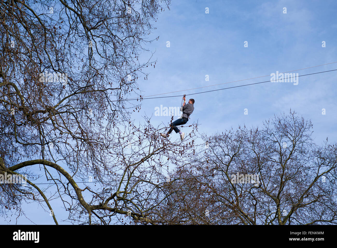 Man using a Zip wire in Battersea Park activity centre London - Stock Image
