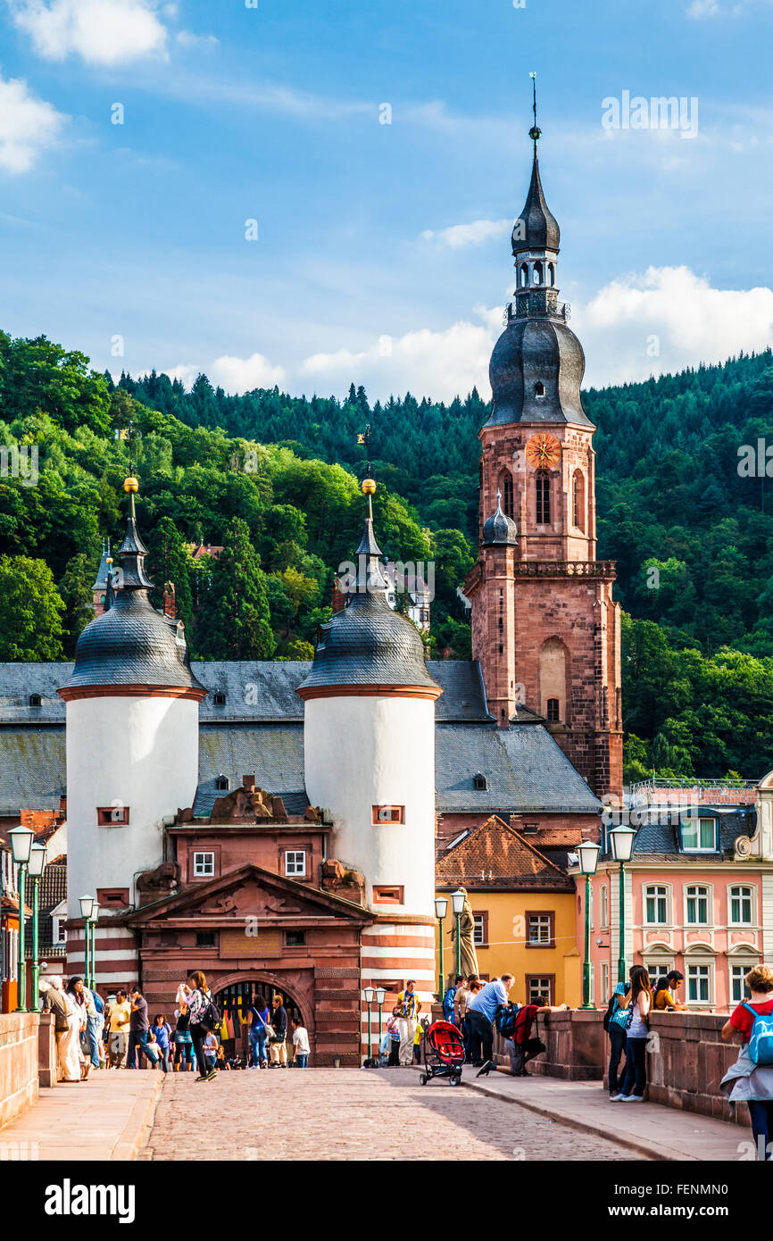 The towers and gate at the southern end of the Karl-Theodor-Brucke or Old Bridge in Heidelberg with the Heiliggeistkirche - Stock Image