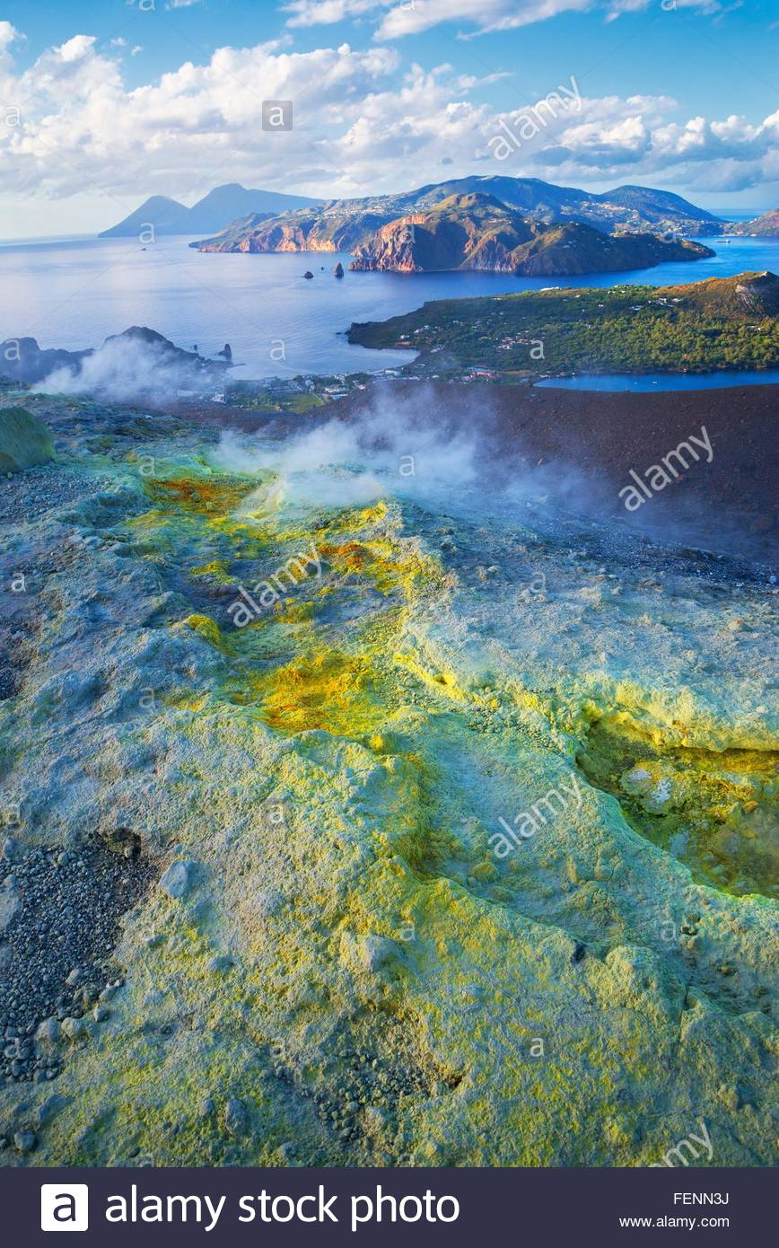 High angle view of coast and sulphur smoke at Gran Cratere, Vulcano Island, Aeolian Islands, Sicily, Italy - Stock Image