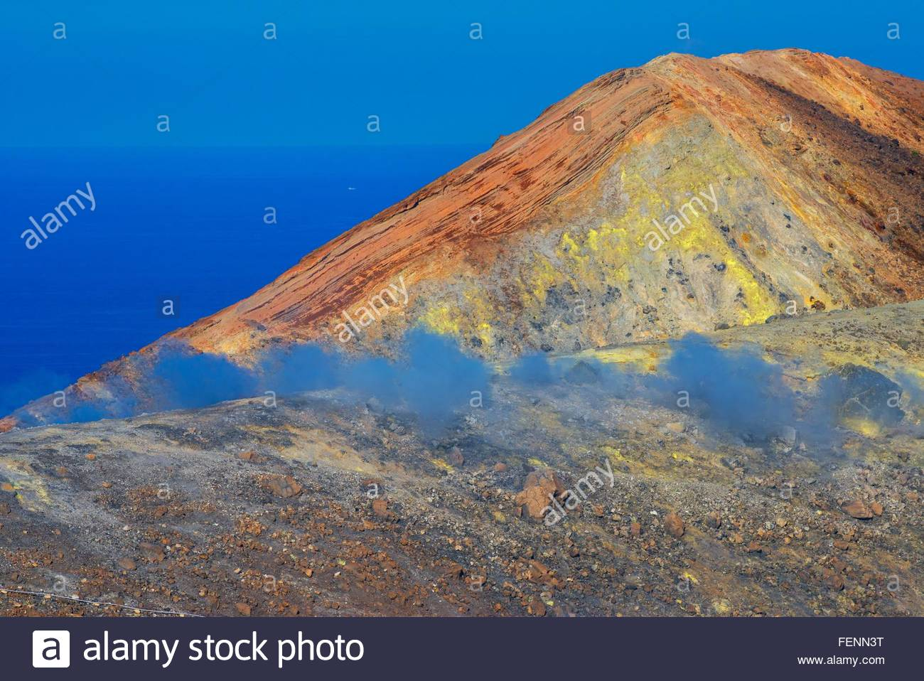 View of coast fumarole and sulphur smoke at Gran Cratere, Vulcano Island, Aeolian Islands, Sicily, Italy - Stock Image