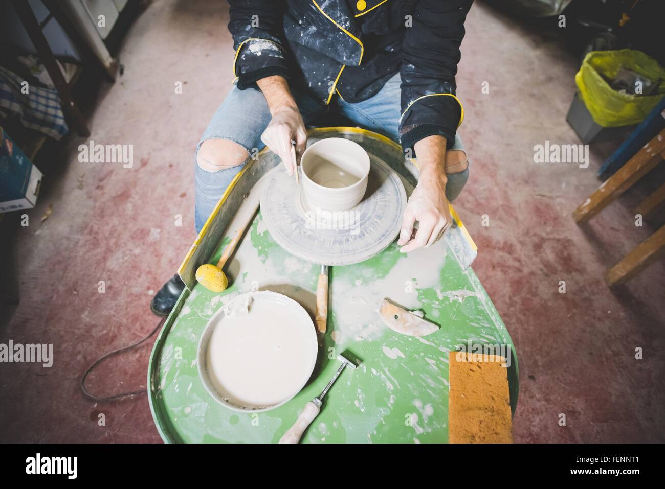 High angle view of mid adult man making clay pot on pottery wheel Stock Photo