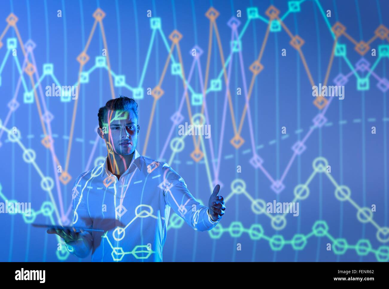 Businessman making presentation with graphical projected images - Stock Image