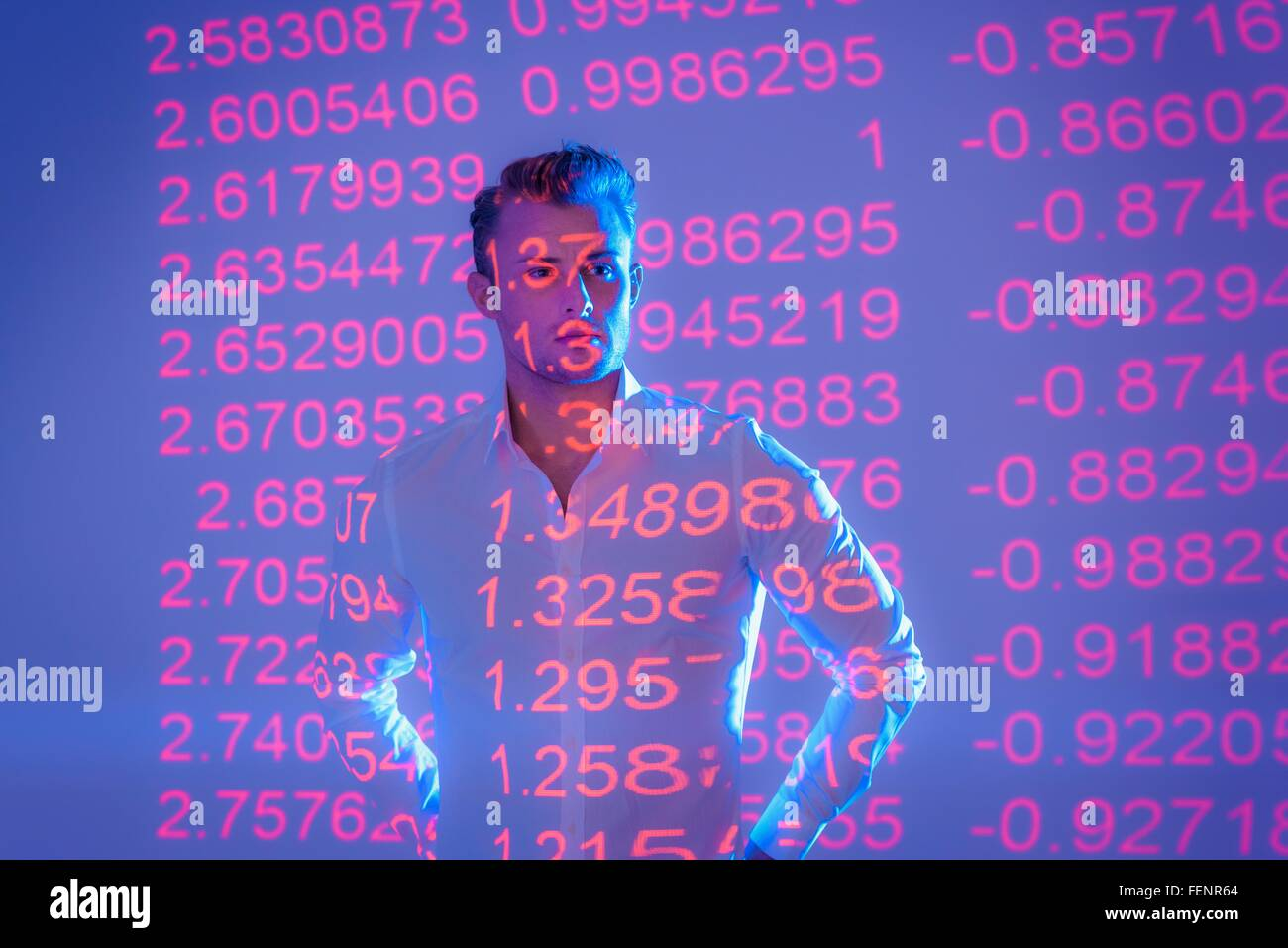 Businessman with projected financial data - Stock Image