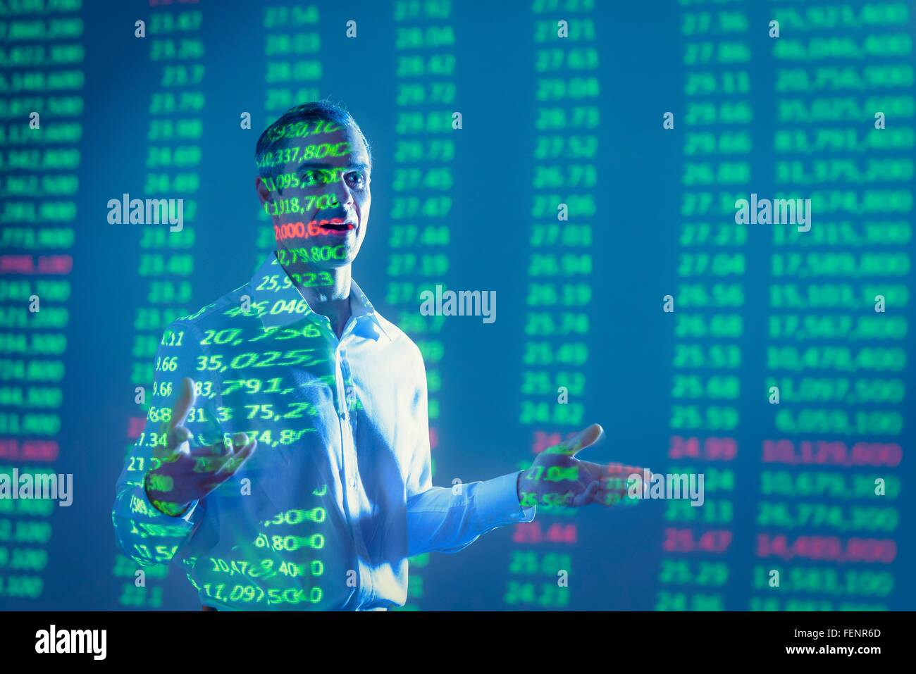 Businessman making presentation with projected financial data - Stock Image