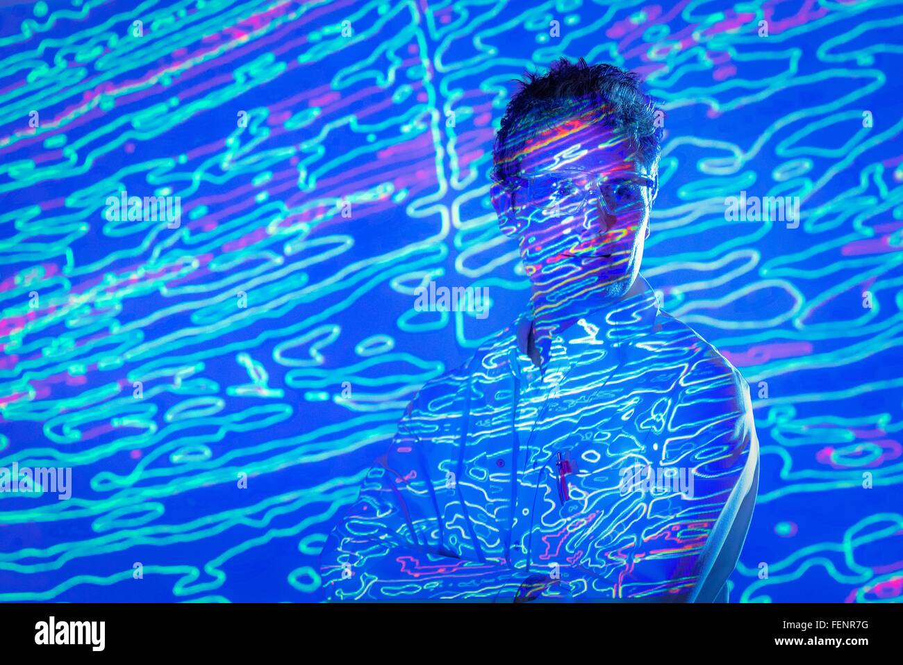 Portrait of male scientist with graphical geological data projection - Stock Image