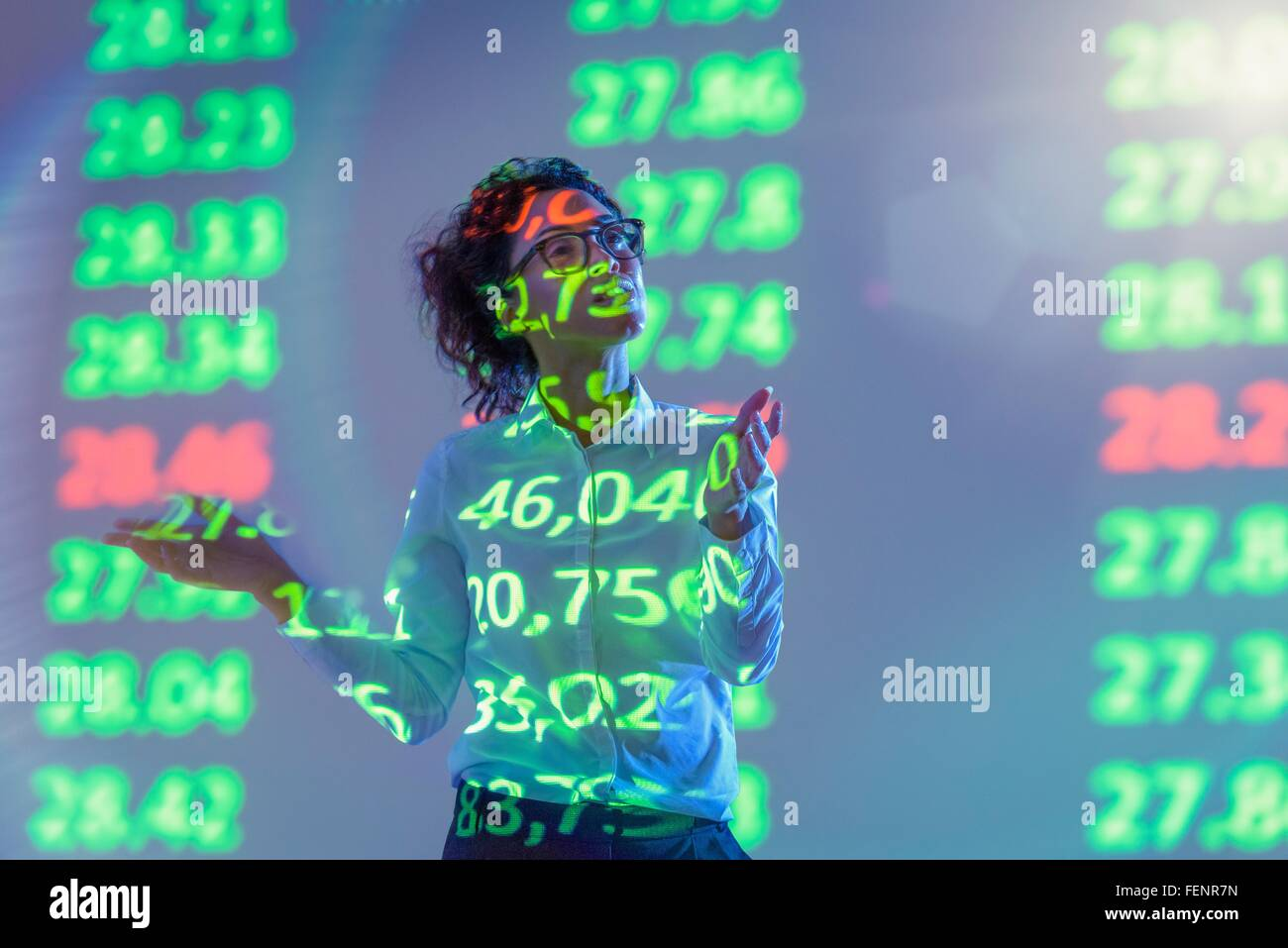 Businesswoman making presentation with graphical financial data projection - Stock Image
