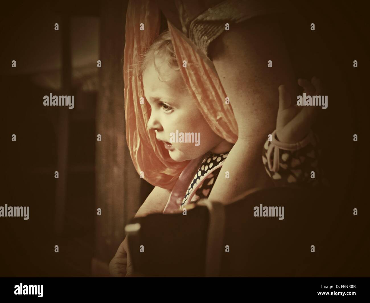 Girl With Mother Looking Out Window - Stock Image