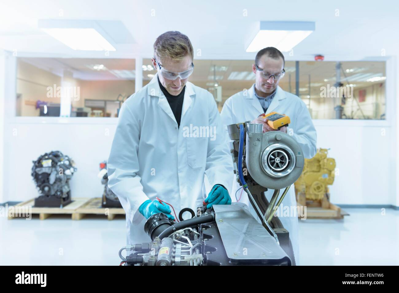 Scientists working in turbo charger automotive research laboratory - Stock Image