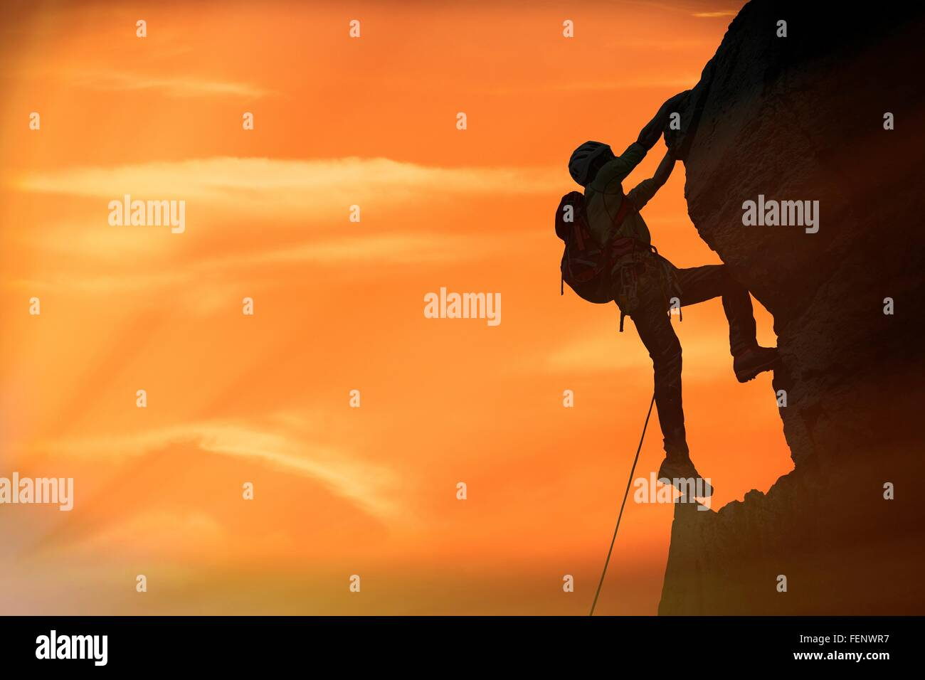 Climber on rocky wall at sunset, Mont Blanc, France - Stock Image