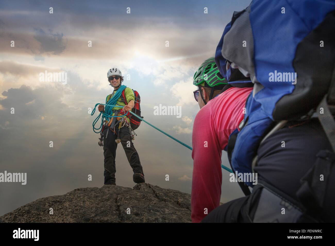 Climber on mountain top holding rope for partner, Mont Blanc, France Stock Photo