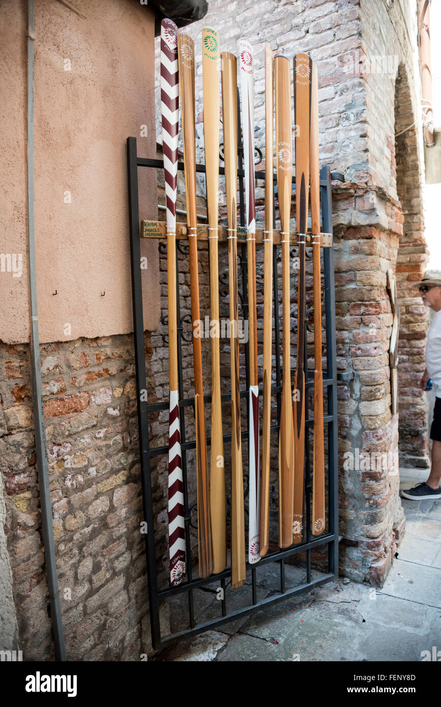 A stack of oars outside Paolo Brandolissio 's oar maker's workshop in Venice, Italy - Stock Image