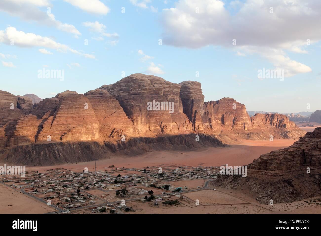 Elevated view of village by mountain range, Wadi Ram, Jordan - Stock Image