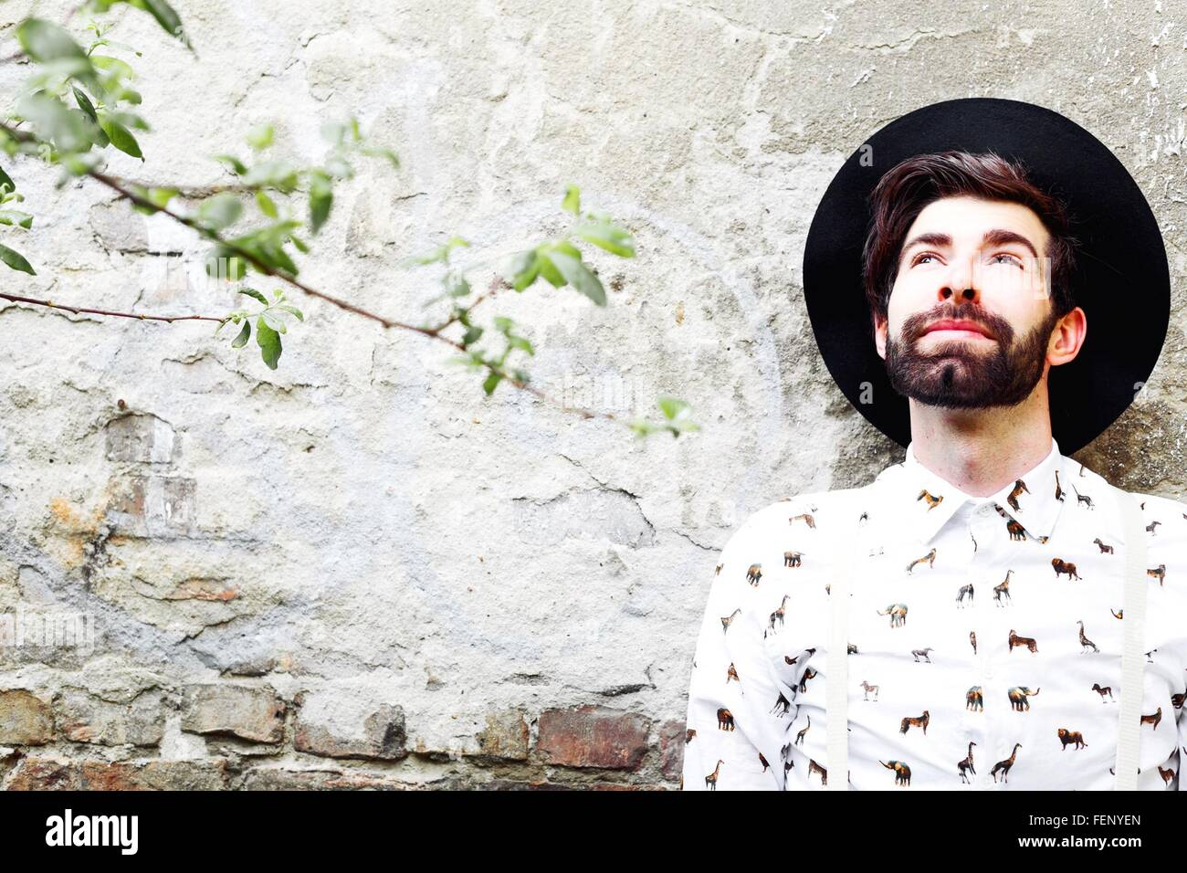 Man Wearing Hat Looking Up - Stock Image