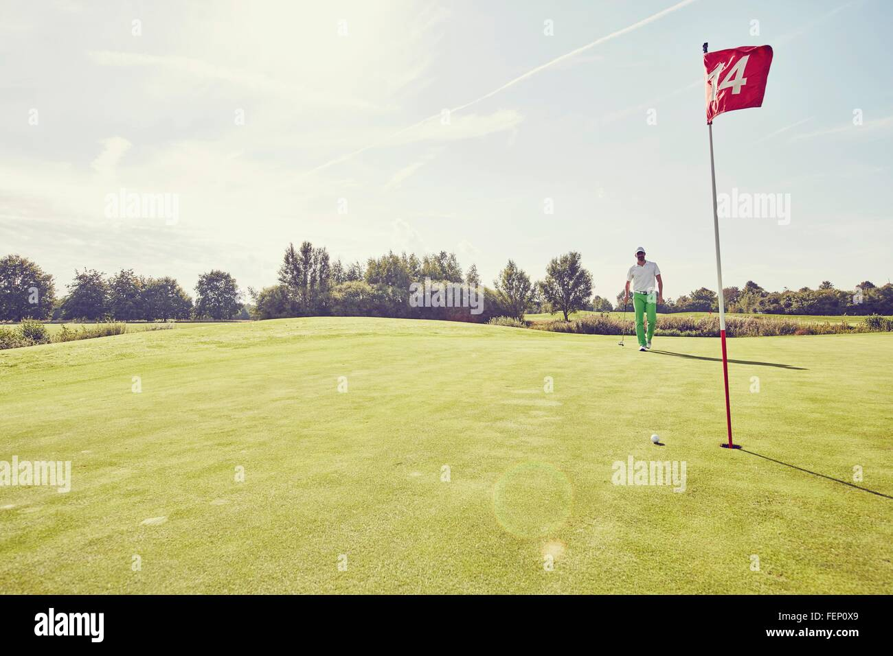 Golfer playing golf, near 14th hole, Korschenbroich, Dusseldorf, Germany - Stock Image