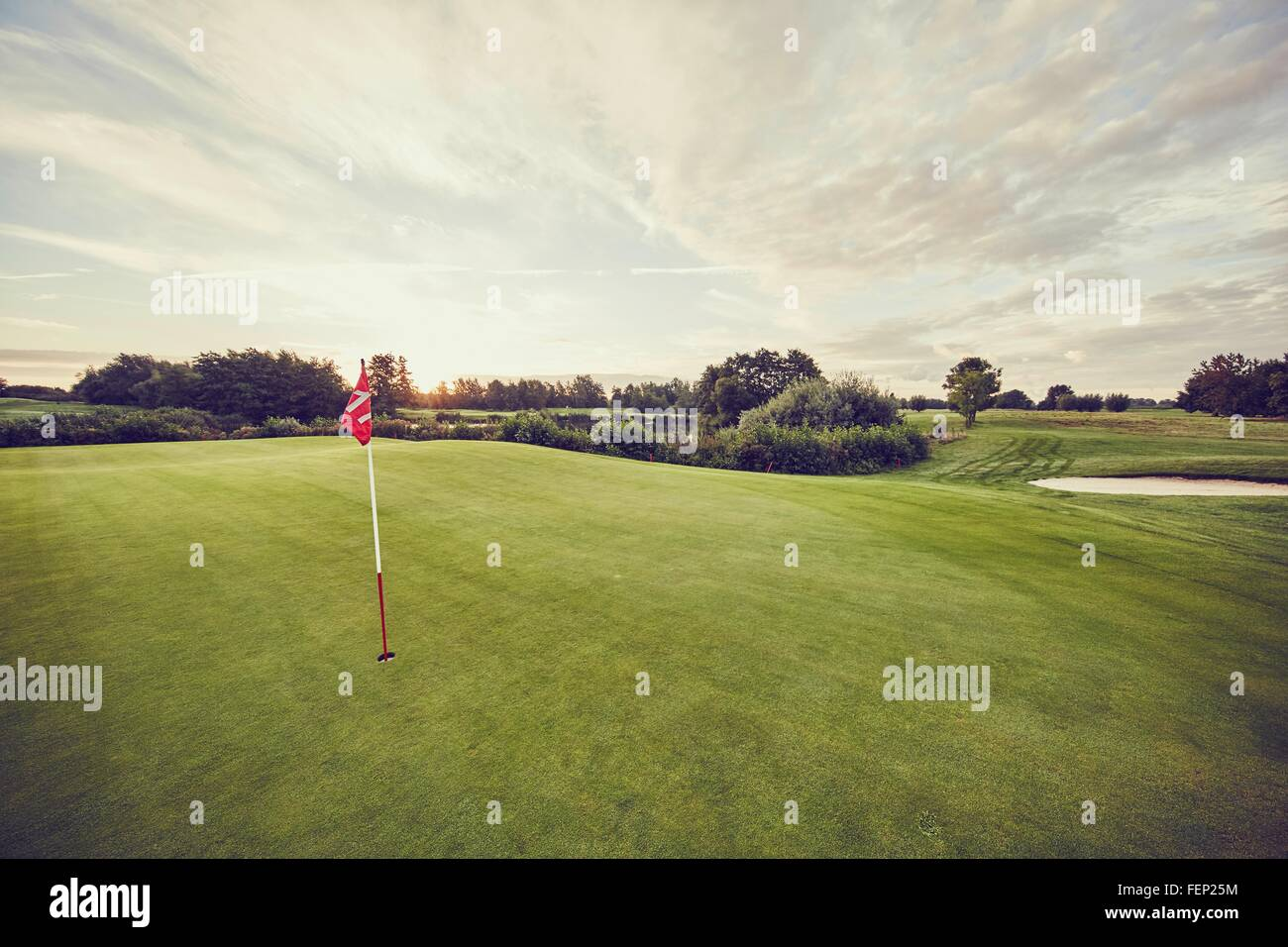 Flag in hole on golf course, Korschenbroich, Dusseldorf, Germany - Stock Image