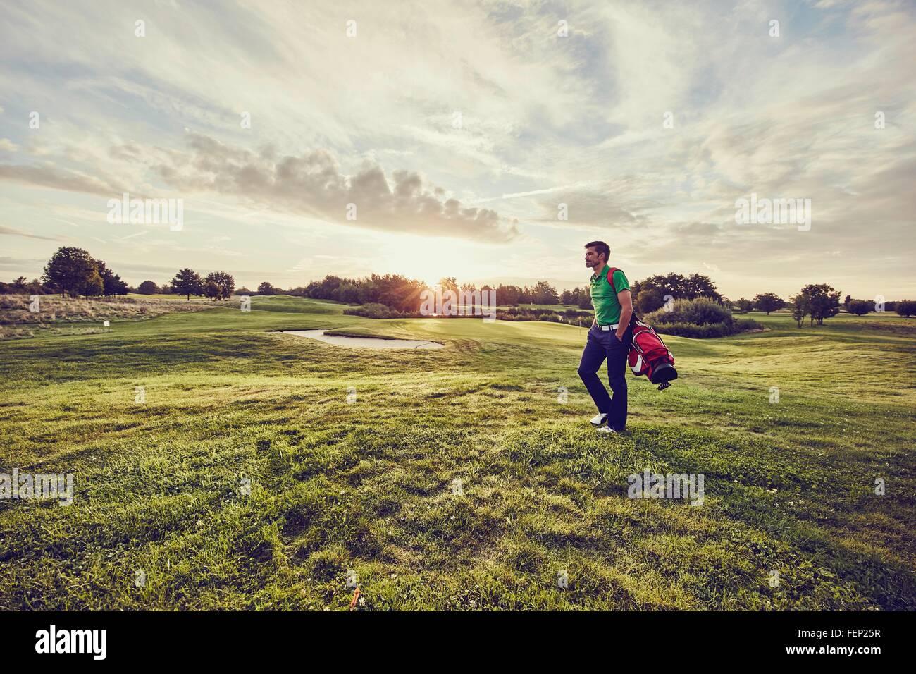 Golfer walking on course, Korschenbroich, Dusseldorf, Germany - Stock Image