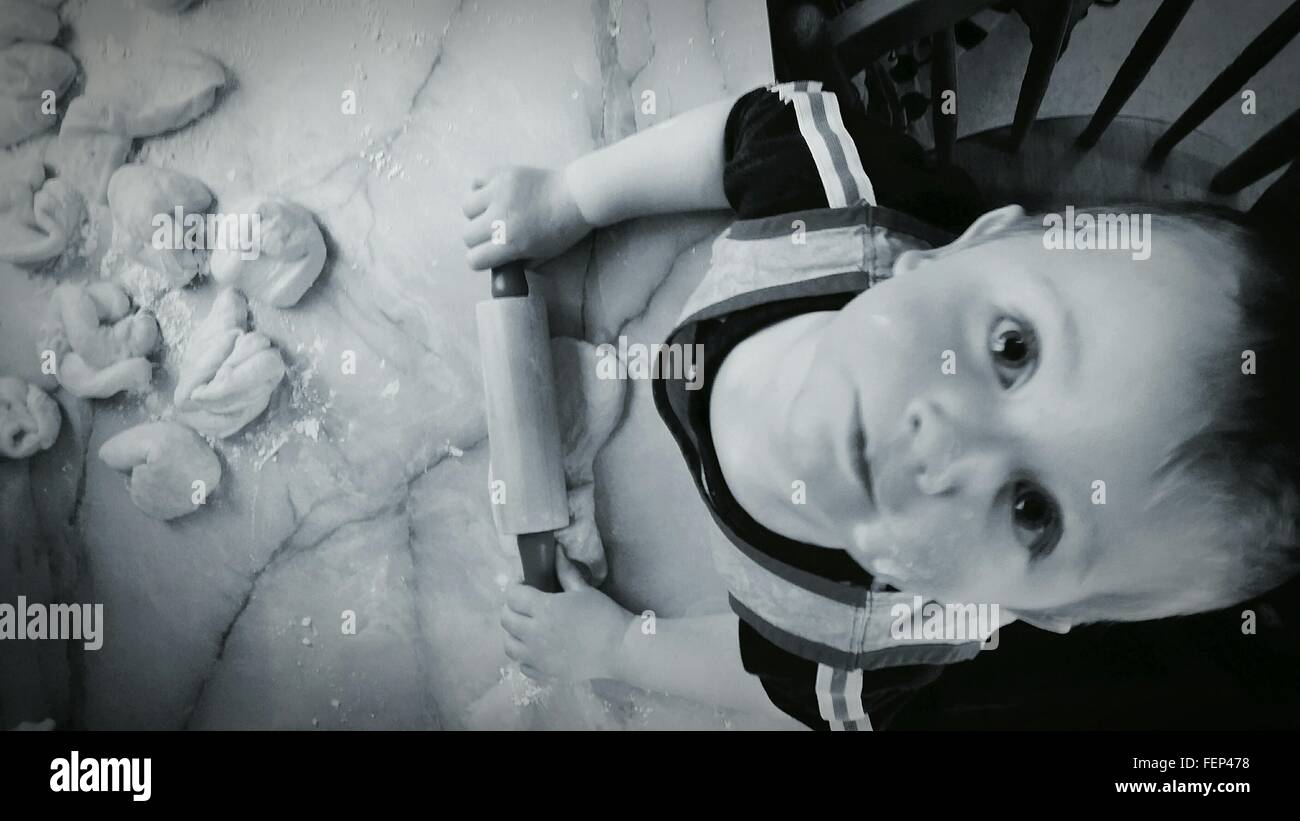 Cute Baby Baking In Kitchen - Stock Image
