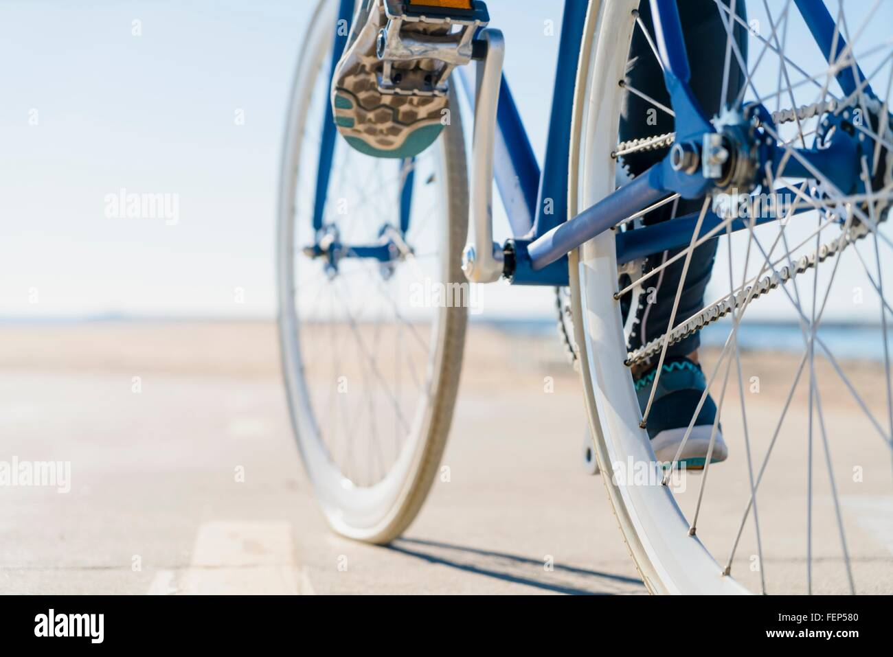 Woman cycling, low section, close-up Stock Photo