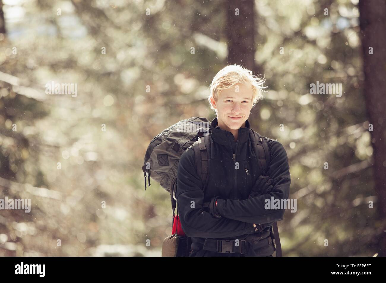 Portrait of young male hiker in sunlit forest, Ashland, Oregon, USA - Stock Image