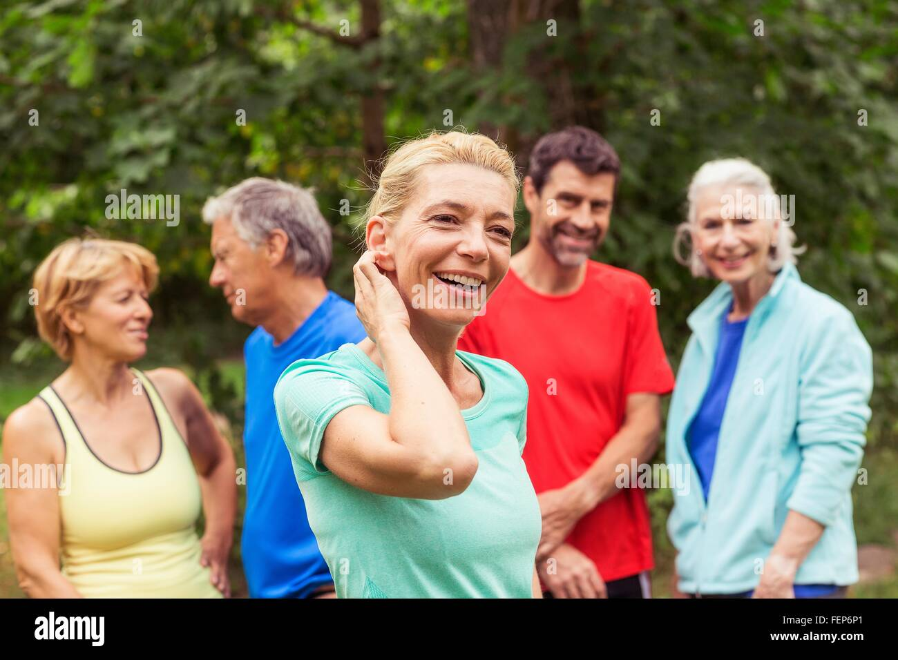 Group of adults, outdoors, smiling - Stock Image