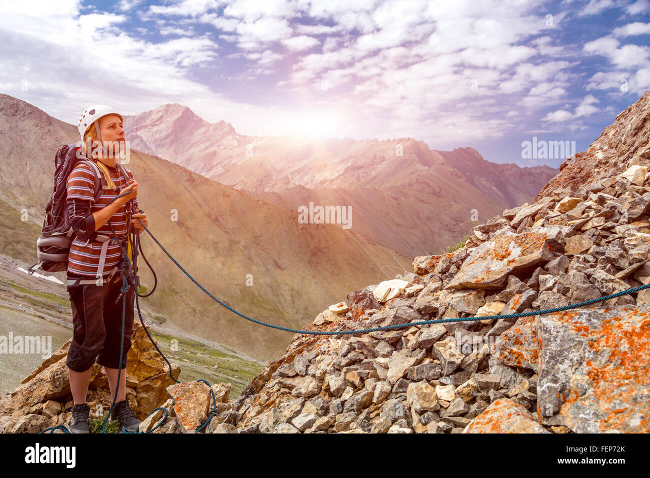 Mountain climber working with rope - Stock Image