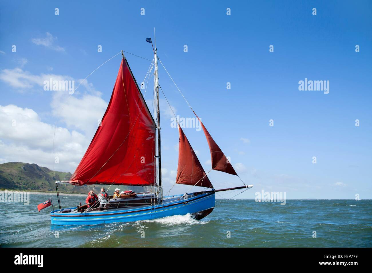 Small group of adults on sailing boat - Stock Image