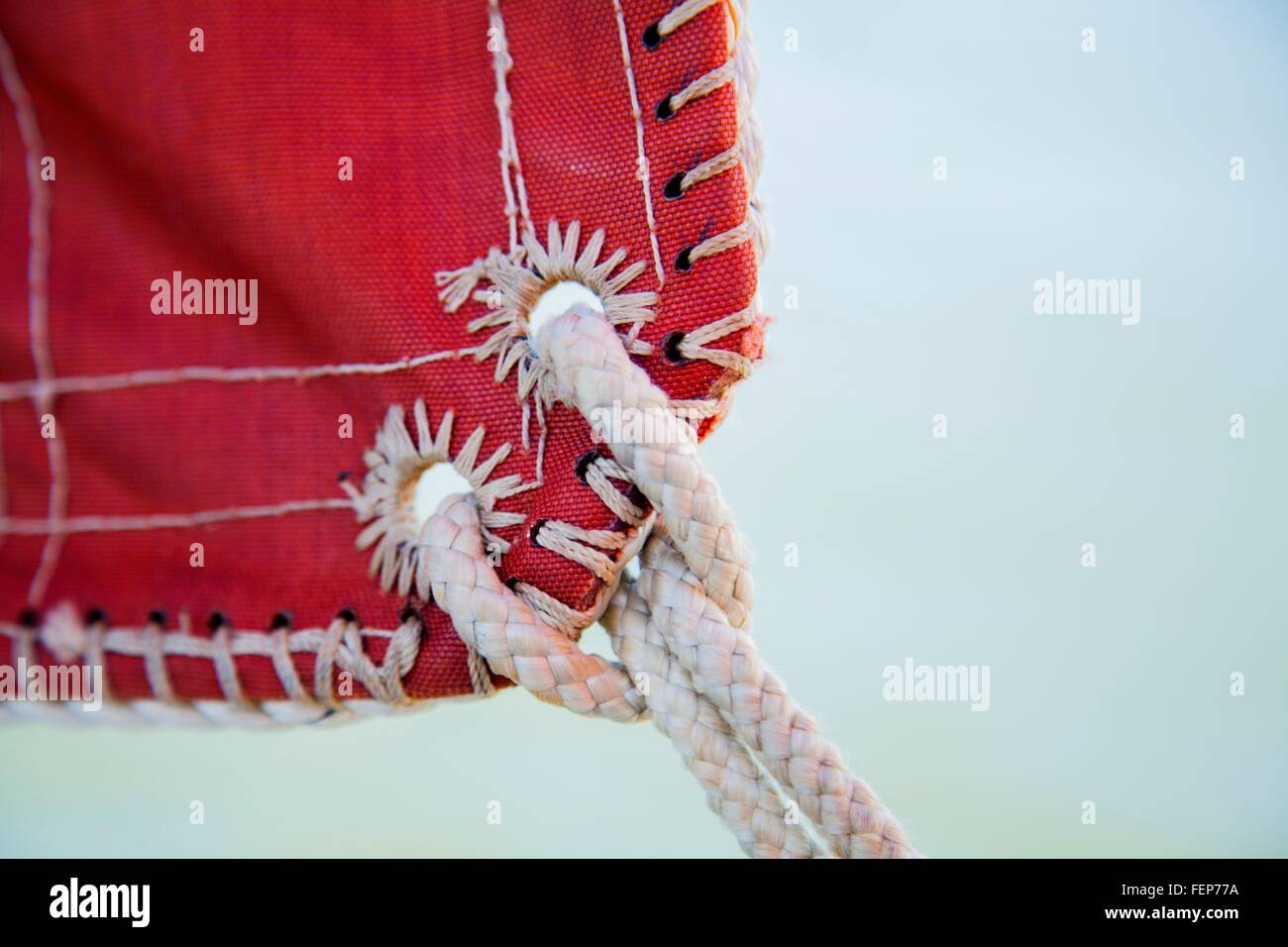 Sail and knot of rope on sailing boat, close-up - Stock Image