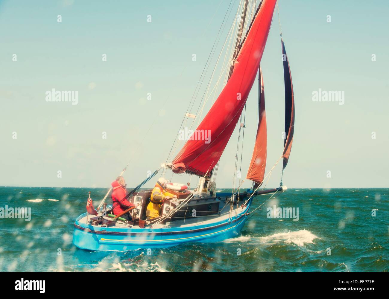 Two men on sailing boat - Stock Image