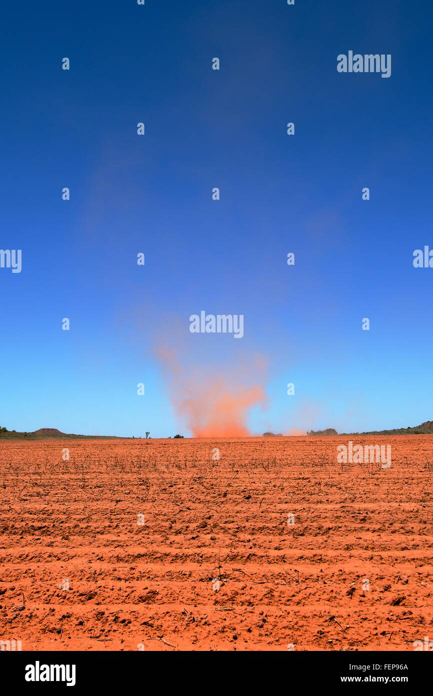 South of Amarillo, Texas, a large dust devil spins in a red-earth field, 22 May 2013 - Stock Image