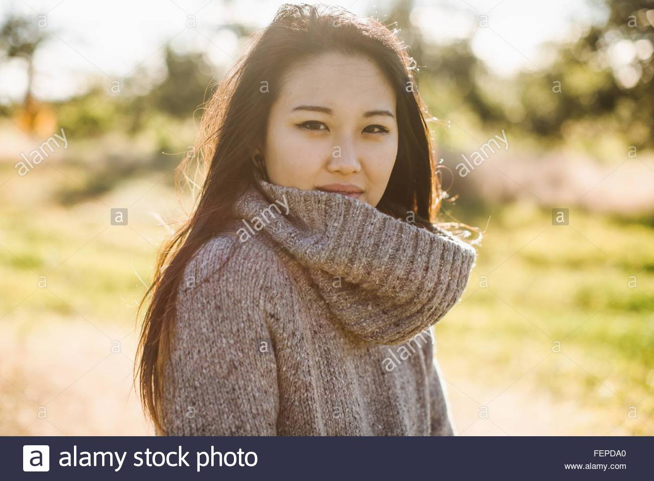Portrait of young woman in rural environment - Stock Image
