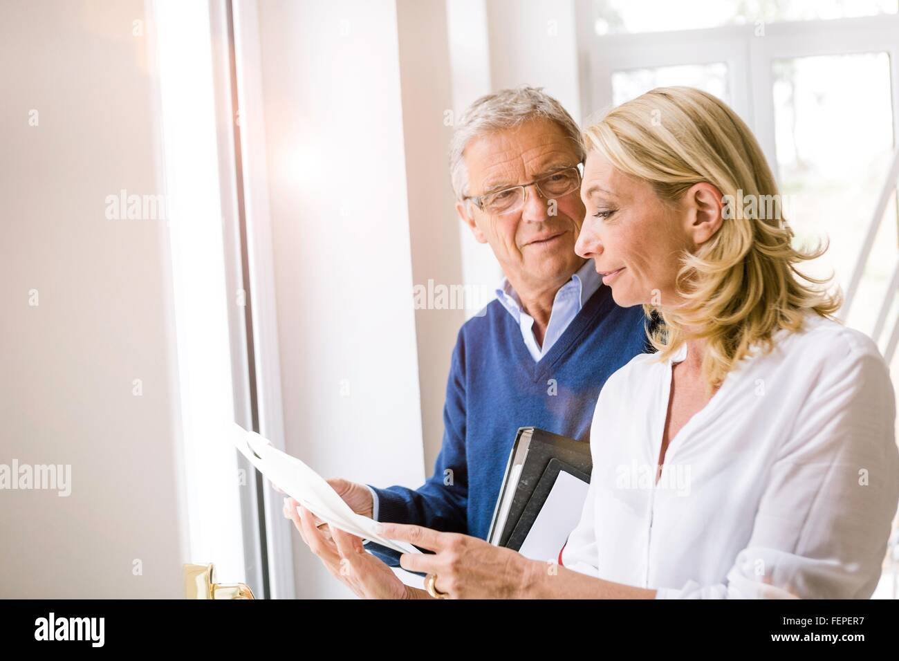 Couple discussing paperwork - Stock Image