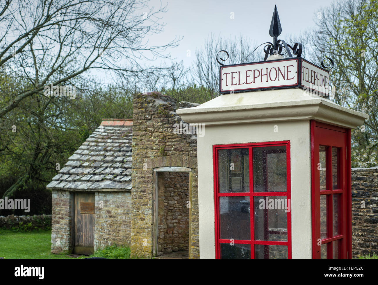 Old-fashioned telephone box in the abandoned village of Tyneham in Dorset, England, UK - Stock Image