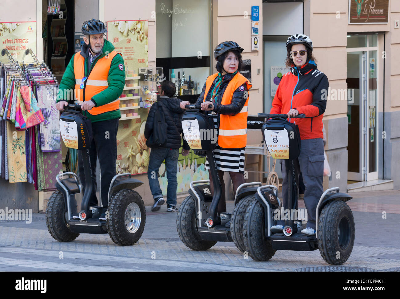 Malaga, Costa del Sol, Malaga Province, Andalusia, southern Spain.  Visitors exploring the city streets using Segways - Stock Image